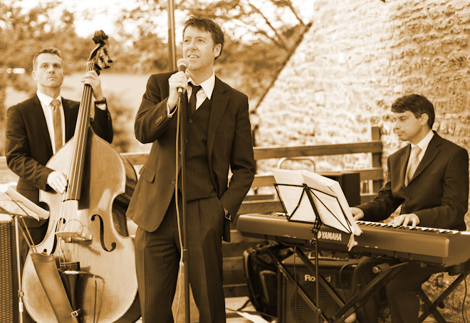 Photo:  The Hipcats jazz and swing trio at Wick Farm, Bath, Wiltshire.